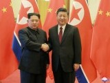 north-korean-leader-kim-jong-un-shakes-hands-with-chinese-president-xi-jinping-as-he-paid-an-unofficial-visit-to-china-2