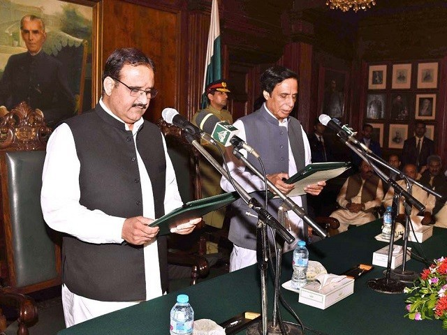 Punjab CM Usman Buzdar and Punjab Assembly Speaker Pervaiz ELahi. PHOTO:  PID