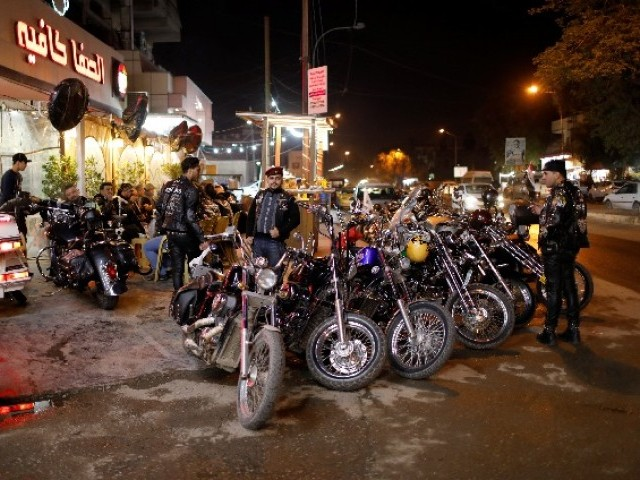 Members of the Iraq Bikers, the first Iraqi biker group, gather outside a cafe in Baghdad, Iraq. PHOTO: REUTERS