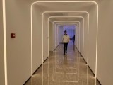 staff-member-walks-in-the-hallway-during-a-demonstration-to-the-media-at-alibaba-groups-futuristic-flyzoo-hotel-in-hangzhou