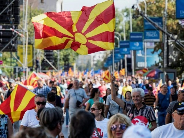 "People wave Macedonian flags at a ""yes"" campaign rally in Skopje ahead of the referendum on whether to change the country's name to ""Republic of Northern Macedonia"". PHOTO: AFP"