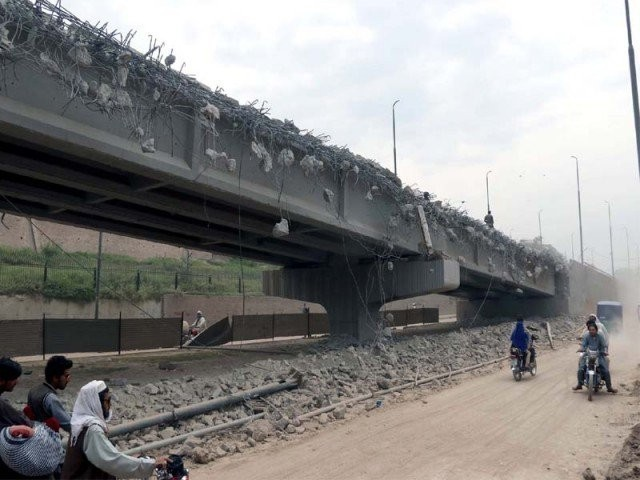 File photo of Malik Saad Shaheed Flyover being razed to pave way for the BRT project. PHOTO: EXPRESS