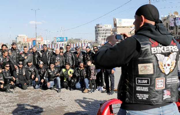A member of the Iraq Bikers, the first Iraqi biker group, takes a group photo in Baghdad, Iraq. PHOTO: REUTERS