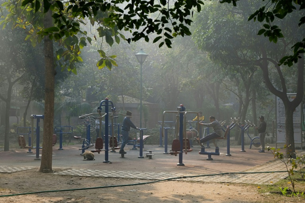 People still exercise on a morning of heavy air pollution at Lodhi Gardens in New Delhi. PHOTO: AFP