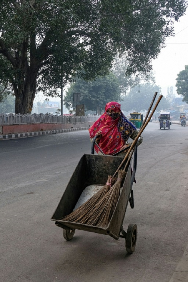 'I come at 6:30 in the morning. My eyes burn, I cough often,' says streetsweeper Lajwanti of working out side in Delhi's toxic air. PHOTO: AFP