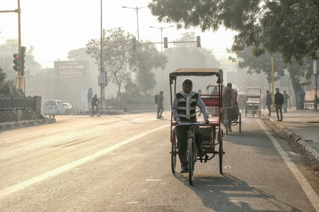 Doctors warn against strenuous exercise -- which requires deeper breathing -- when the pollution spikes in Delhi but the city's cycle rickshaw drivers have no choice but to work. PHOTO: AFP
