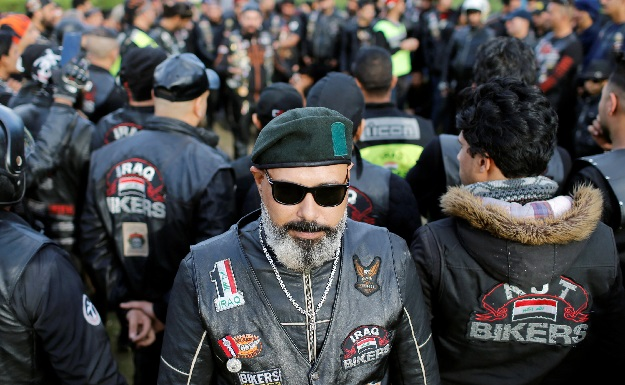 A member of the Iraq Bikers, the first Iraqi biker group, poses for a photograph before riding his motorbike on the streets of Baghdad, Iraq. PHOTO: REUTERS