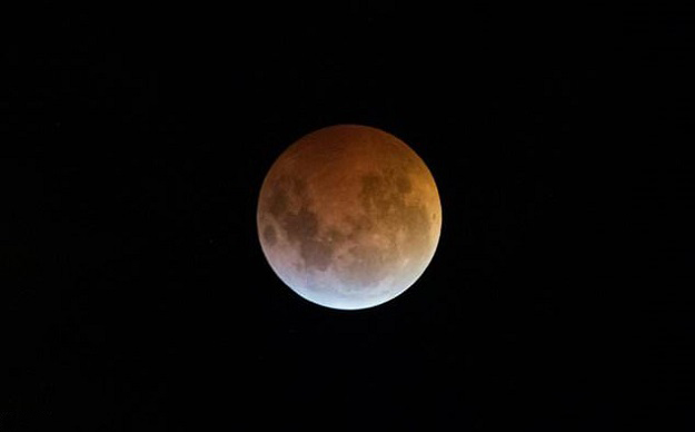 The Earth's shadow almost totally obscures the view of the so-called Super Blood Wolf Moon during a total lunar eclipse. PHOTO: AFP