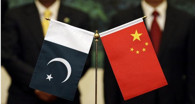 chinese-president-hu-and-his-pakistani-counterpart-zardari-stand-near-their-respective-countrys-flags-in-beijing-5-3-2-2-3-2