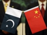 chinese-president-hu-and-his-pakistani-counterpart-zardari-stand-near-their-respective-countrys-flags-in-beijing-5-3-2-2-3-2-2