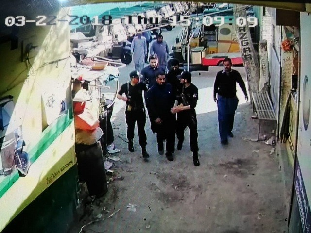 Screengrab of CCTV footage showing Sultan Zameen being taken into police custody.