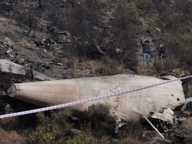 En route to Islamabad, PIA flight PK-661 from Chitral crashed in the hills of Gagan near Havelian city. PHOTO: AFP
