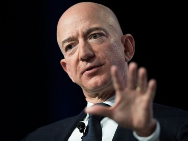 In a post on blogging platform Medium Thursday, Jeff Bezos (seen) said Enquirer publisher American Media Inc (AMI), led by David Pecker, approached him with a threat to publish the photos if he did not halt an investigation into the motives behind that leak. PHOTO: AFP