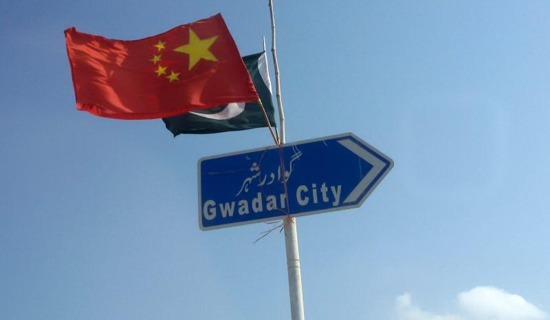 the-chinese-and-pakistani-flags-fly-on-a-sign-along-a-road-towards-gwadar-3-2-3-2