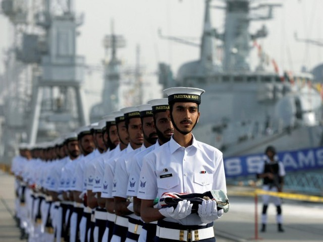 Pakistan Navy's servicemen carry national flags of participating countries during the opening ceremony of multinational exercise AMAN-19, in Karachi, February 8, 2019. PHOTO: REUTERS