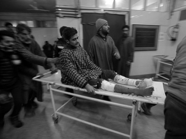A boy is rushed to a hospital in Srinagar for treatment after he was injured in an explosion inside a school in occupied Kashmir's Pulwama district February 13, 2019. PHOTO: REUTERS