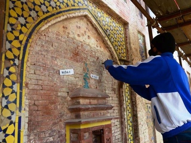 Restoration work of a wall in Sahi Qila under way. PHOTO: EXPRESS