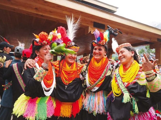 Kalasha women dance at the closing ceremony of Chilam Joshi festival in Kalash Valley. PHOTO: MUHKAMUDDIN/EXPRESS