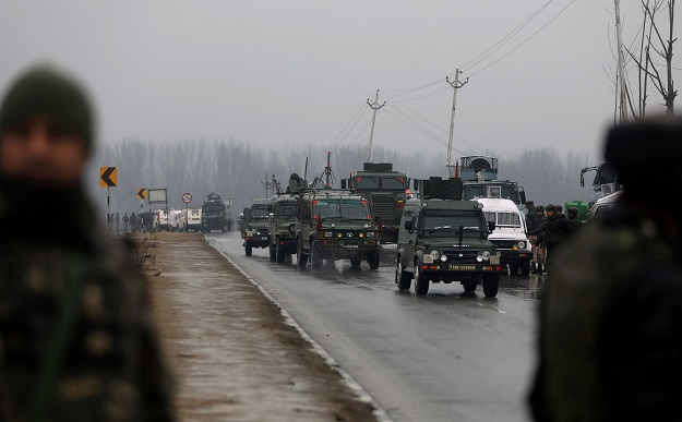 Indian security forces stand guard along the Srinagar-Jammu Highway. -AFP