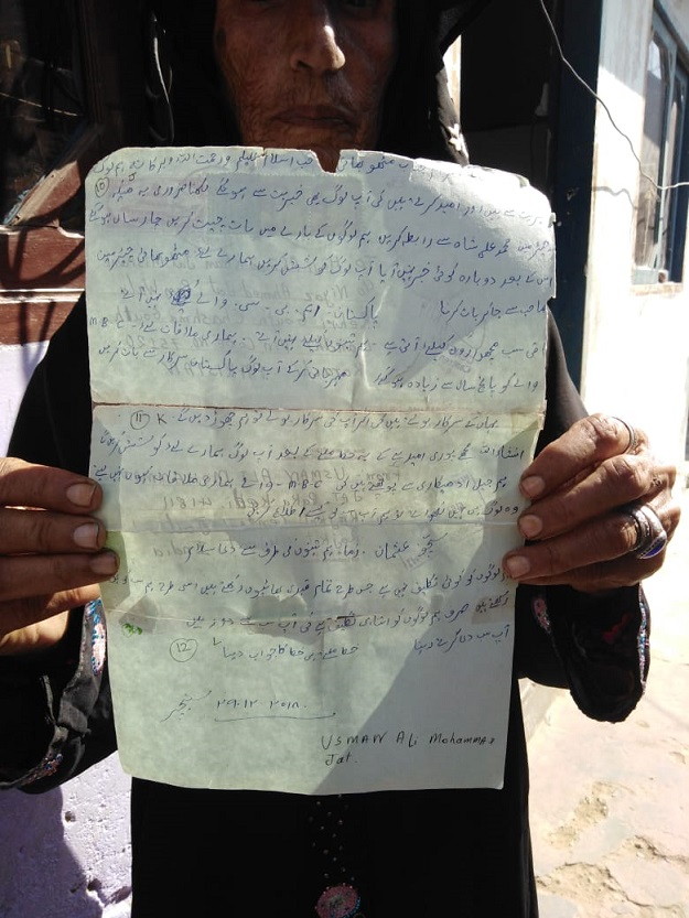Woman holding letter sent by her brother ( the fisherman imprisoned in India). PHOTO: Express