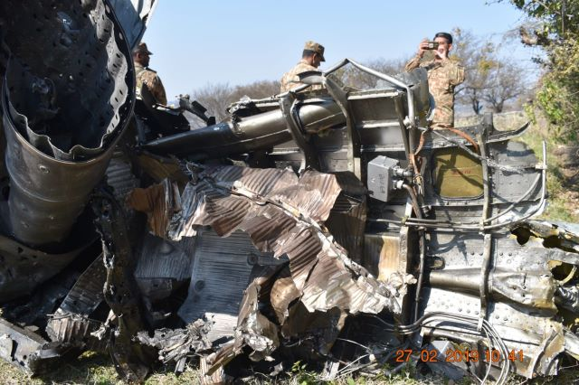 Pakistan Army inspects wreck of downed IAF jet. -EXPRESS