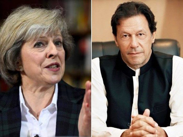 British prime minister welcomes her Pakistani counterpart's decision of releasing the Indian pilot. FILE PHOTOS