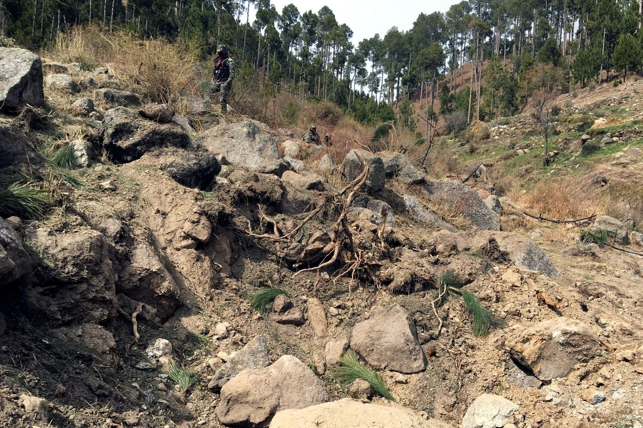 The crater where Indian military aircrafts released payload in Jaba village, Balakot, Pakistan. PHOTO: REUTERS