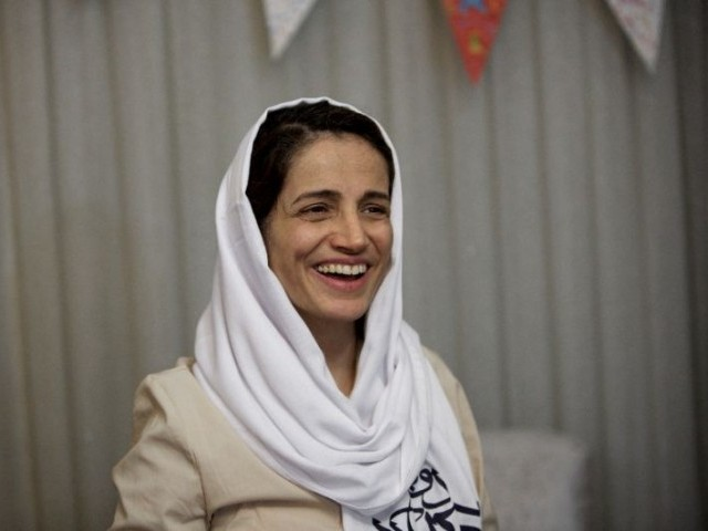 Award-winning Iranian human rights lawyer Nasrin Sotoudeh smiles at her home in Tehran on September 18, 2013, after being freed following three years in prison on state security charges. PHOTO: REUTERS