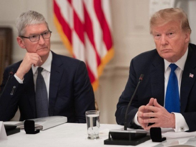 Apple CEO Tim Cook listens to US President Donald Trump during an American Technology Council roundtable at the White House in Washington DC