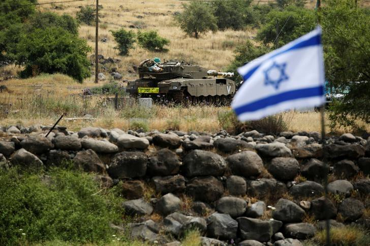 an-israeli-tank-can-be-seen-near-the-israeli-side-of-the-border-with-syria-in-the-israeli-occupied-golan-heights-2