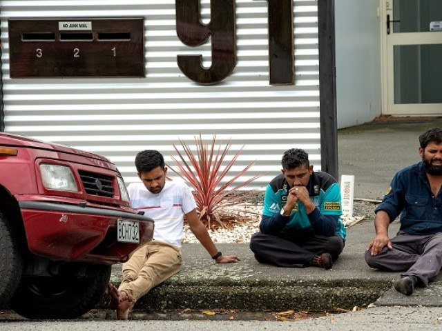 Grieving members of the public following a shooting at the Al Noor mosque in Christchurch New Zealand