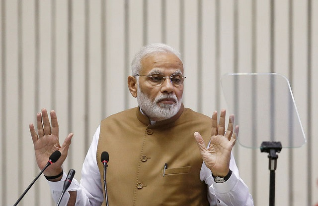file-photo-indias-prime-minister-narendra-modi-gestures-as-he-addresses-the-gathering-during-the-global-mobility-summit-in-new-delhi-4