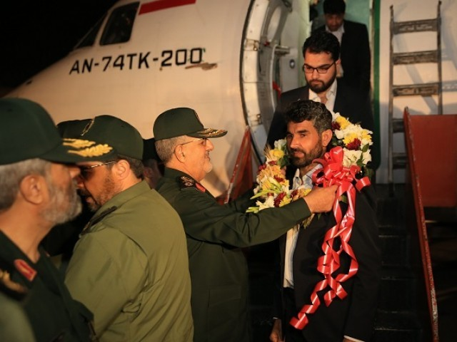 Brigadier-General Mohammad Pakpour (3rd-L), commander of the Islamic Revolutionary Guard Corps ground forces, welcomes four freed Iranian border guards who had been held captive by a militant group in Pakistan's  restive southwest, upon their arrival at an undisclosed location in Iran on March 22, 2019. - The four Iranian border guards were among the 12 Iranian security personnel, who were abducted in October last year by the Sunni jihadist group Jaish al-Adl, rescued by the Pakistan military from militants and returned to Tehran to a hero's welcome, state television reported. PHOTO: AFP