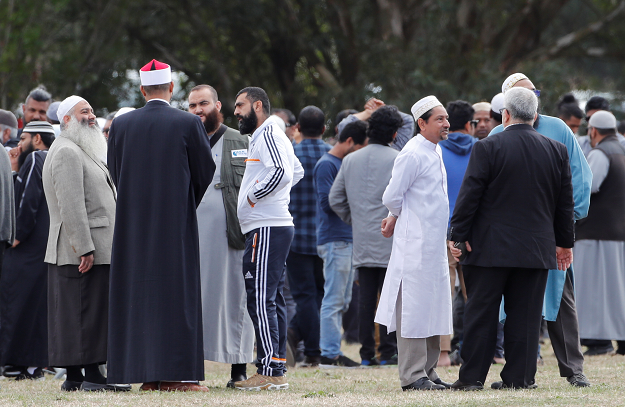 Relatives and other people arrive to attend the burial ceremony of the victims of the mosque attacks. PHOTO: REUTERS