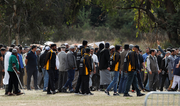 Bodies of victims of the mosque attacks are carried during the burial ceremony. PHOTO: REUTERS