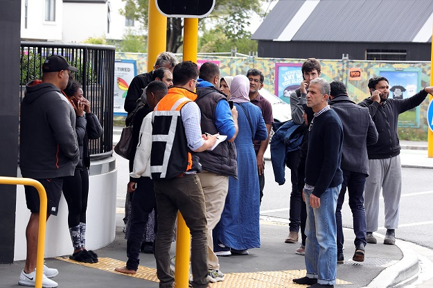 residents gathering close to the mosque after a firing incident in Christchurch. PHOTO: AFP