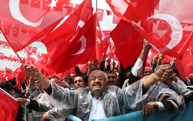 Supporters cheer Turkey's President Recep Tayyip Erdogan as he addresses an election rally in Golbasi. PHOTO: AFP