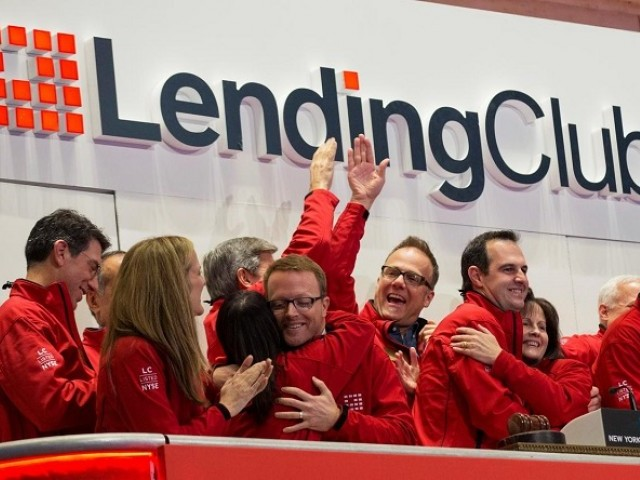 Renaud Laplanche, (2nd R) Founder and CEO of Lending Club, celebrates with company executives after ringing the opening bell during their IPO at the New York Stock Exchange (NYSE) in New York, US, December 11, 2014. PHOTO: REUTERS
