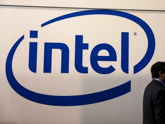 A visitor passes an Intel logo at the Mobile World Congress in Barcelona, Spain, February 26, 2018. PHOTO: REUTERS