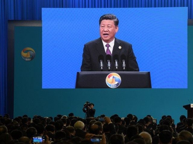 Chinese President Xi Jinping is seen on a screen as he speaks during the opening ceremony of the Belt and Road Forum in Beijing in April 26, 2019. PHOTO: AFP