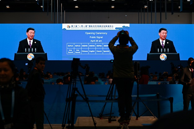 A large video screen shows Chinese President Xi Jinping speaking during the opening ceremony of the Belt and Road Forum at a media centre in Beijing on April 26, 2019. PHOTO: AFP