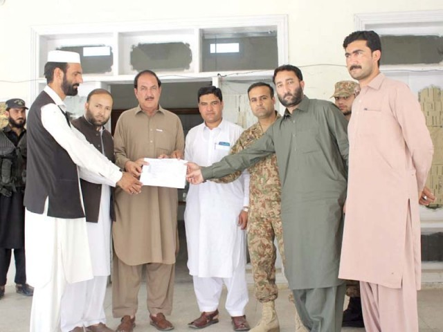 Major Raheel handing over Bajaur Press Club to acting president of the club Irfan Ullah. PHOTO: EXPRESS