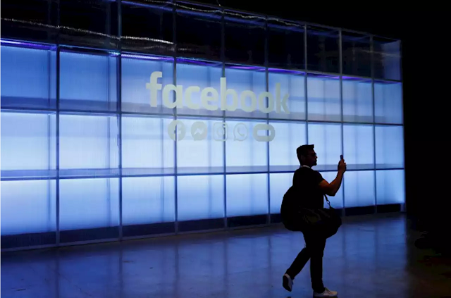 An attendee takes a photograph of a sign during Facebook Inc's F8 developers conference in San Jose, California, US, April 30, 2019. PHOTO: REUTERS