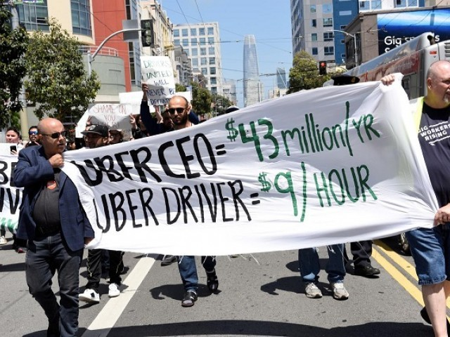 Protestors march through the financial district, demanding fair wages and more transparency during a strike against Uber in San Francisco, California, US, May 8, 2019. PHOTO: REUTERS