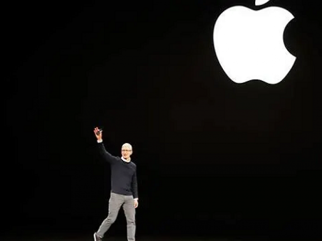 Tim Cook CEO of Apple waves to attendees during an Apple special event at the Steve Jobs Theater in Cupertino California US