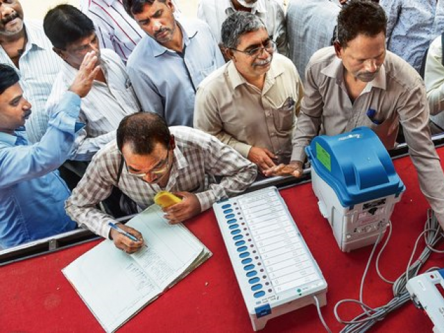 More than 67 per cent of the electorate turned out to use the machines during seven rounds of voting. PHOTO: AFP