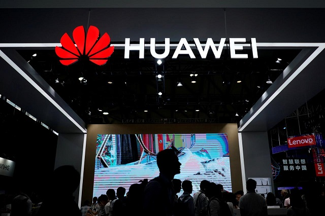 file-photo-people-walk-past-a-huawei-sign-at-ces-consumer-electronics-show-asia-2018-in-shanghai-2-2-2-2-2