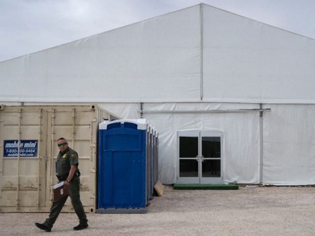 A US Border Patrol agent walks by a new temporary holding facility opened by Customs and Border Protection personnel on the US-Mexico border in El Paso, Texas. PHOTO: AFP