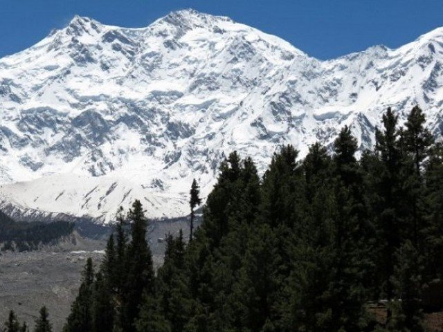 A black glacier is bulldozing its way down a valley in Hunza, threatening to cut off a vital road link to China. PHOTO: AFP
