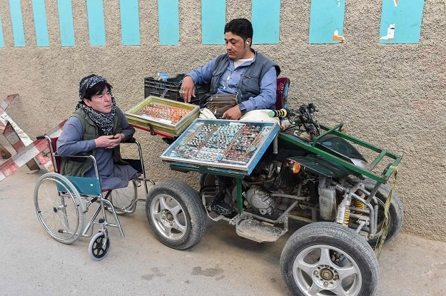 In this picture taken on May 3, 2019, a Pakistani disabled vendor (R) belonging to the Hazara minority Muslim community waits for customers at a roadside in Hazara town, a neighbourhood in Quett. PHOTO: AFP